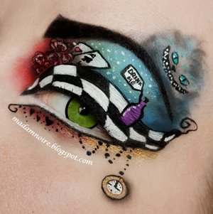 Stunning Alice in Wonderland eye makeup by Madam Noire. Check out her blog and list of products here: http://madamnoire.blogspot.fi/2013/10/alice-in-wonderland.html