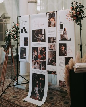 """The Wedding Stylist - @thejoytroopers exceeded all my expectations when it comes to doing up our wedding venue. Together With @fleurboutique.sg, they provided and created ideas according to our style and our love. The photo display was a great hit with the guests! Instead of a wedding album, @thejoytroopers decided to """"build"""" a photo display filled with our stories and photos from our prewed shoots that's scrollable!"""