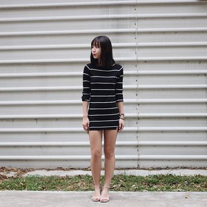 Keeping warm in the rainy weather with @wonderstellar's Alexi knit stripe dress.  Quote
