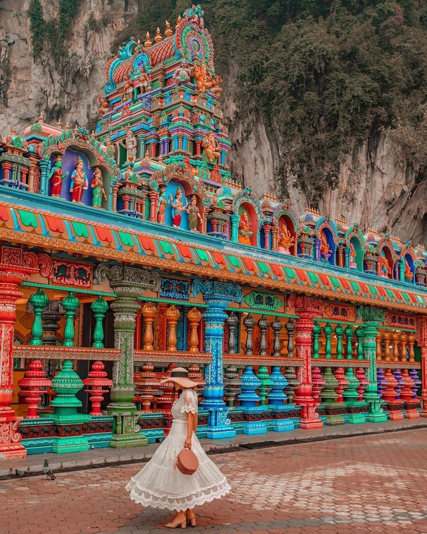 Colourful landmark photography of a woman at Batu Caves