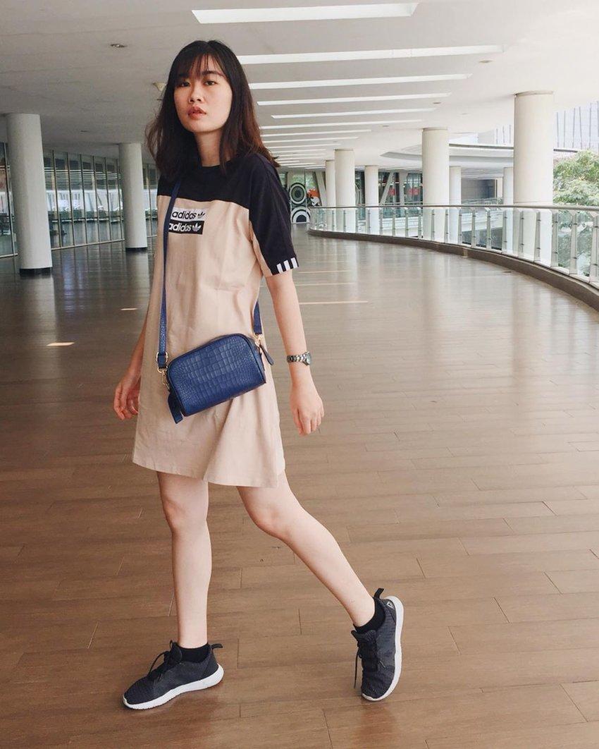 Girl in a long shirt dress