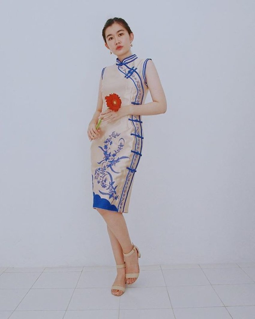 gold cheongsam with blue floral details