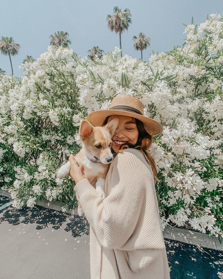 Girl with her puppy